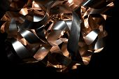 Silver And Copper Metal Curved Metal Ribbon Chandelier Closeup. Modern Metal Lampshade. Metallic And poster
