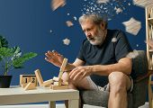 Drown Image Of Losing Of Mind. Old Bearded Man With Alzheimer Desease Has Problems With His Hands Mo poster