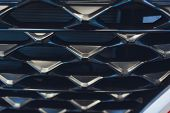 Grid Of Car With Sunflare. Radiator Grille. Metal Close-up Texture Background. Chrome Grill Of Big P poster