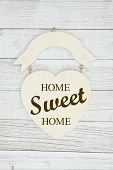 Home Sweet Home Message On A Wood Heart Sign On Weathered Whitewash Textured Wood poster