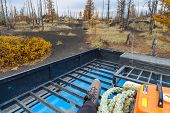Travel On The Roof Of A Truck. Leg In A Trapper Boots. Equipment Off Road Expedition, Rope And Yello poster