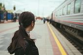Young Woman Waiting For Arrival Of Train Side View Unrecognizable Young Brunette Female Standing On  poster