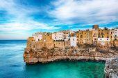 Polignano A Mare Village On The Rocks At Sunset. Polignano A Mare, Apulia, Italy, Province Of Bari. poster