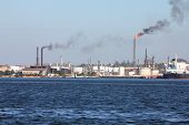 stock photo of polution  - Air polution generated by oil refinery in Havana Cuba - JPG