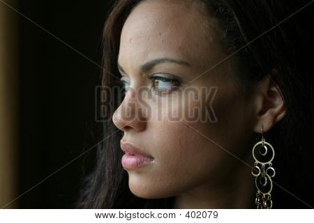 Young, Beautiful Woman Looking Out The Window