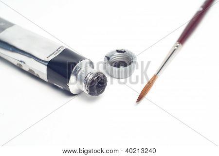 Brush And Tube Of Paint Close-up Isolated On White Background