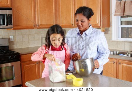 Girl And Mother Cooking