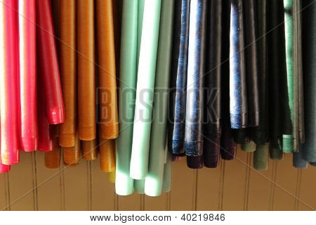Colorful hanging tapered candles