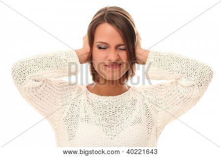 Young woman closing her ears in stress over a white