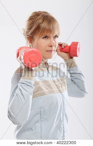 Woman doing exercise with dumbbells view from the back