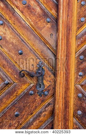 Ancient door handle on old door in Olomouc, Czech Republic.