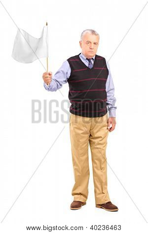 Full length portrait of a sad senior man waving a white flag isolated on white background