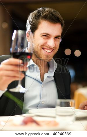 Handsome man holding a glass of wine