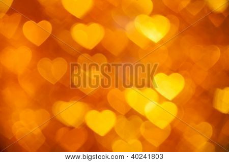 golden hearts bokeh as background