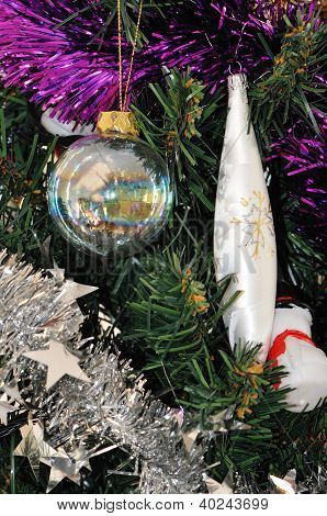 Some Christmas Decoration In A Plastic Pine