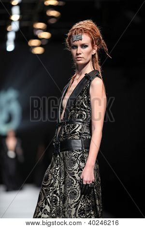 ZAGREB, CROATIA - OCTOBER 18: Fashion model wears dress made by Hippy Garden at 'Croaporter' fashion show, on October 18, 2012 in Zagreb, Croatia.