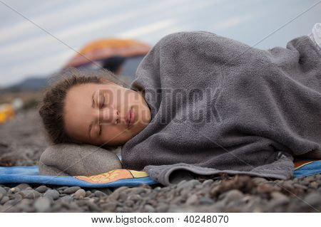 Beautiful Young Woman Lying On The Beach