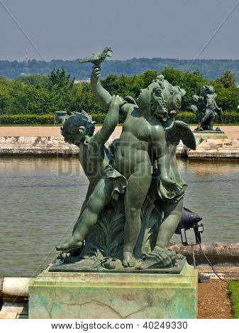 Sculptures And Pond  Of Royal Residence At Versailles Near Paris In France