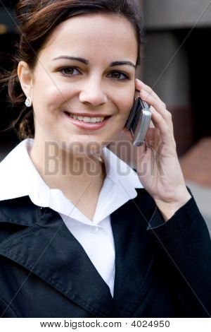 Happy Businesswoman On The Cell Phone