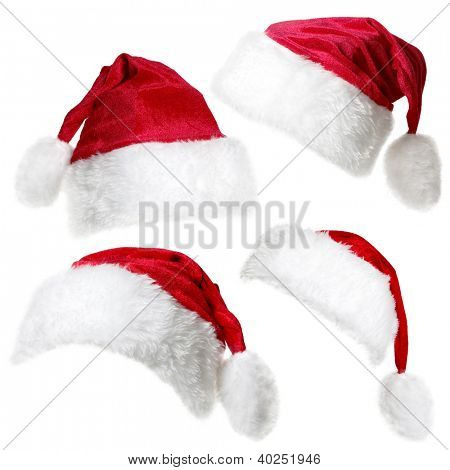 Set of  red Santa Claus caps isolated on a white background