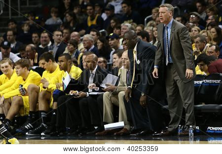 BROOKLYN-DEC 15: Michigan Wolverines head coach John Beilein (R) reacts on the sidelines against the West Virginia Mountaineers at Barclays Center on December 15, 2012 in Brooklyn.