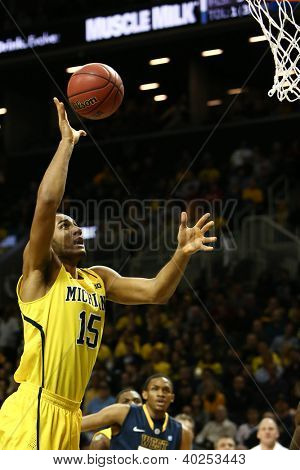 BROOKLYN-DEC 15: Michigan Wolverines forward Jon Horford (15) goes up for a shot against the West Virginia Mountaineers during the first half at Barclays Center on December 15, 2012 in Brooklyn.