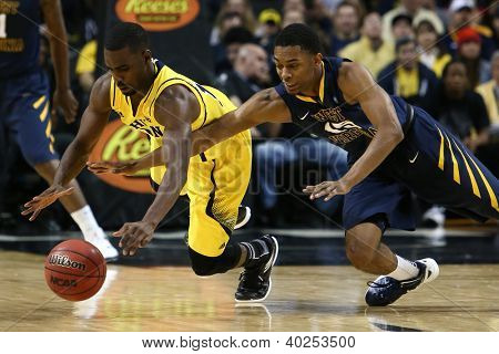 BROOKLYN-DEC 15: Michigan Wolverines guard Tim Hardaway Jr. (10) and West Virginia Mountaineers guard Terry Henderson (15) battle for the ball at Barclays Center on December 15, 2012 in Brooklyn.