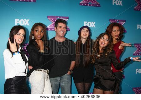 .LOS ANGELES - DEC 17:  Fifth Harmony, Simon Cowell at the 'X Factor' Season Finale Press Conference at CBS Television City on December 17, 2012 in Los Angeles, CA