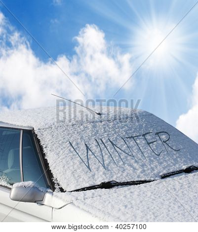 Close up of a snow-cowered car. Winter transportation and insurance concept.