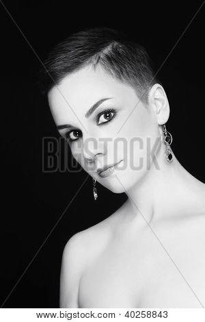 Black and white portrait of young attractive woman with stylish short haircut