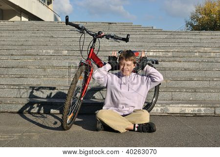 The jolly boy with his bicycle