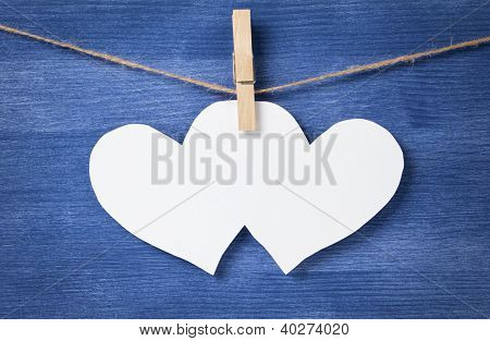 Two Blank White Hearts Over Wood Wall