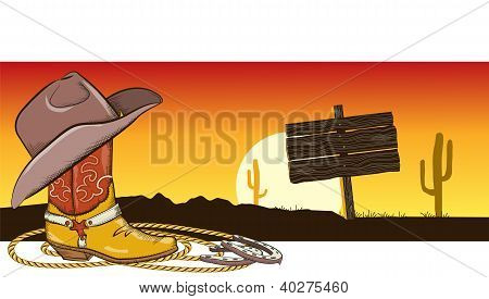 Western Image With Cowboy Clothes And Desert Landscape