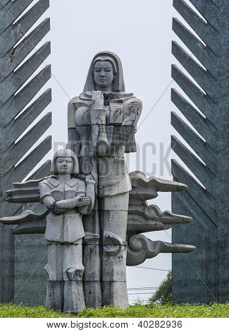 Vietnam - DMZ: detail of war memorial showing mother and child.