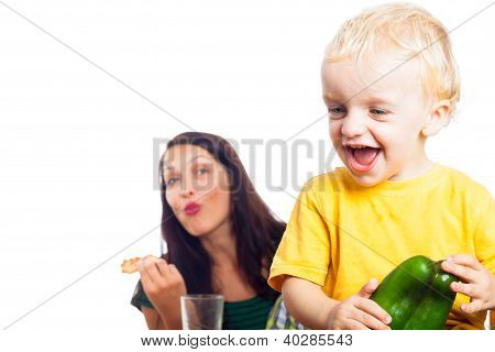 Happy Child With Green Pepper