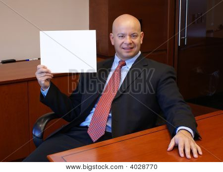 Office Shot Of A Man Holding Blank Sign.