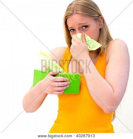 sick woman using tissue on white background