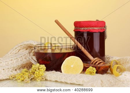 Healthy ingredients for strengthening immunity on warm scarf on yellow background