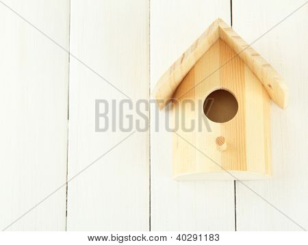 Nesting box on wooden background