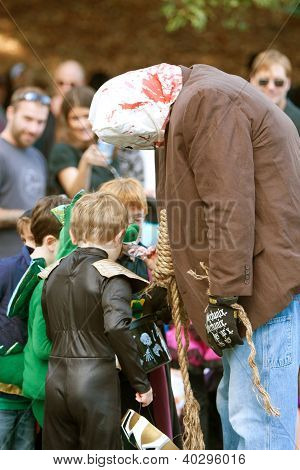 Scary Monster Gives Out Candy In Halloween Parade