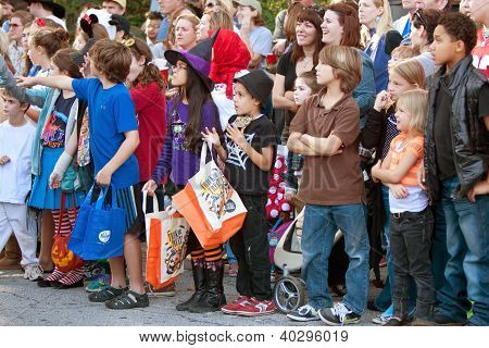 Kids Wait For Candy During Halloween Parade