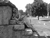 pic of embalming  - Statue on top of tombstone in Greenwood Cemetery in Brooklyn  - JPG