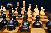 picture of draught-board  - Woody board with black and white chess figures - JPG
