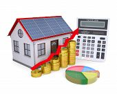 stock photo of solar battery  - House with solar panels calculator schedule and coins - JPG