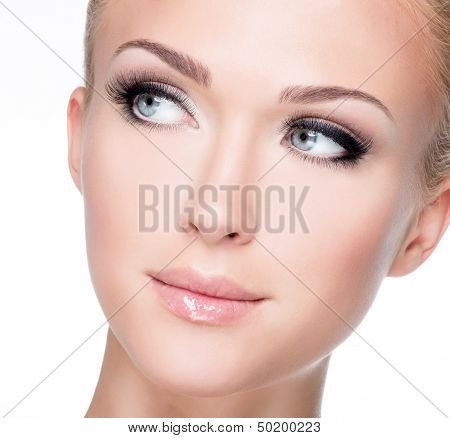 Portrait Of Beautiful White Woman With Long False Eyelashes