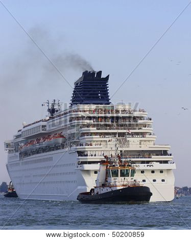 Powerful Tugboat While Accurately Manoeuvre The Large Cruise Ship