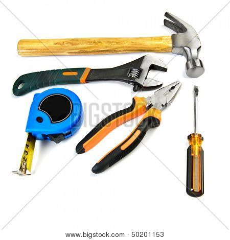 Hammer,  pliers, wrench, screwdriver and tape measure isolated over white background