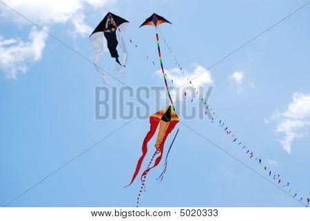 Three Kites Against A Blue Sky