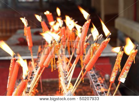 Red Chinese Candles In Temple