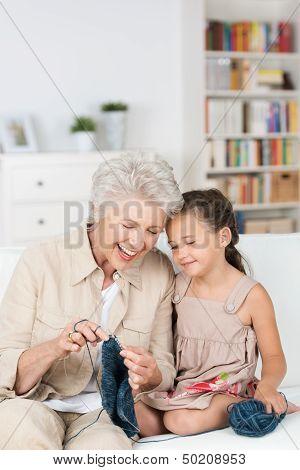 Senior Lady Teaching Her Granddaughter To Knit